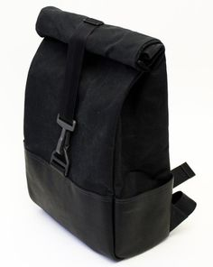 HHI Day Pack - 15 oz Martexin waxed cotton canvas shell partially wrapped in salvaged leather from a NYC bootmaker for support and protection. For hardware they chose an unbreakable buckle originally made to hold a parachute and nylon webbing from a racing harness manufacturer in the Midwest.