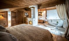 Chalet Hermine - Master bedroom with its own jacuzzi hot tub. Ideal for romantic ski holidays or a short break. Indoor Jacuzzi, Jacuzzi Hot Tub, Courchevel 1850, Luxury Ski Holidays, Small Spa, Cosy Interior, Bedroom With Ensuite, Master Bedroom, Open Fireplace