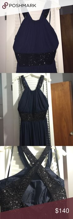 Calvin Klein Formal Dress Worn one time for a few hours. It's a navy blue and black chiffon formal dress from Calvin Klein. It has no signs of being worn and is still in great shape. It's very flattering and flows very nicely. Tried my best to get good pictures but it's honestly a lot nicer in person purchase for $250. It's a size 16! Calvin Klein Dresses Maxi