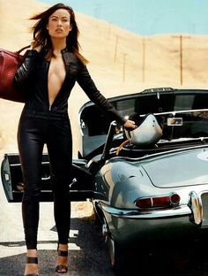 Leather-clad Olivia Wilde poses with a sports car. Hot wheels: Rush star Olivia Wilde posed with a classic sports car in the California desert during an Allure photo shoot for their October i Auto Girls, Car Girls, Olivia Wilde, Sexy Autos, Norman Jean Roy, Xjr, Jaguar E Type, Jaguar Cars, Jaguar Xj