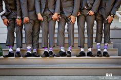Groomsmen show off fun purple socks #weddingphotography / national wedding photographers