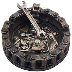 Decorative Motorcycle Chain Ashtray with Wrench http://bikeraa.com/decorative-motorcycle-chain-ashtray-with-wrench-and-bike-motif-great-for-a-biker-bar-harley-mechanics-shop-smoking-room-decor-as-unique-fathers-day-gifts-for-men-or-smokers/