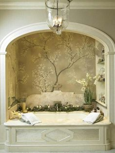 Crown moulding and shelves around the bathtub