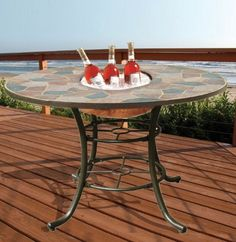 Deeco DM-104201 3-in-1 Rock Canyon Dining Table by Deeco Consumer Products. $499.00. Made of a combination of natures hardy slate and substantial wrought iron powder coated frame. Compact design for smaller patios and porches. Includes 3 unique inserts. 20-inch copperized steel ice basin keeps drinks and food cold during backyard entertaining. Easy to maintain garden accessory. The Rock Canyon 3-in-1 party table includes 3 unique inserts: A 20-inch cast iron fire pit bowl warms...