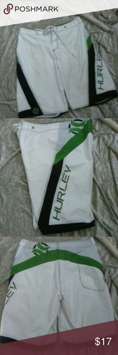 """Men's Hurley Board Surf Shorts Swim Trunks Logo 33 Like new Hurley board surf shorts swim trunks. these are all lined in white. no mesh lining for suit, Embroidered Hurley Lettering on left side and LOGO on left. White with black stitching and black and green  accents no fly opening stretch fabric.  Draw string waist. Back pocket with hidden zipper. Waist measures 17"""" across flat lay, inseam 11"""". Nice detailing! Bundle and save Pre-loved but you might mistake for New! Hurley Swim"""