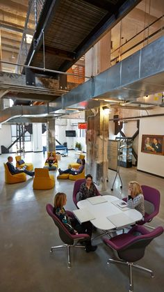 This open space with a variety of seating options encourages social connection and creative collaboration.