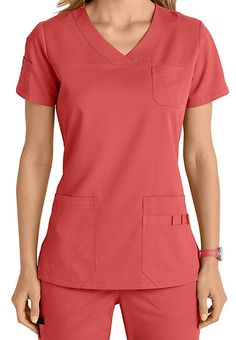 "Meet your new ""go-to"" top! This v-neck top from the popular NrG by Barco collection is loaded with cute accents including two patch pockets, a novelty sleeve pocket, a chest pocket, and pen slots. Healthcare Uniforms, Medical Uniforms, Vet Scrubs, Medical Scrubs, Scrubs Outfit, Scrubs Uniform, Veterinary Scrubs, Stylish Scrubs, Uniform Design"