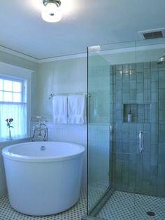 bathroom with round soaking tub