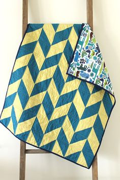 craftyblossom: blue and green herringbone baby quilt.