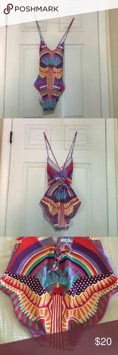 NWOT tribal swimsuit Never been worn! Super colorful, stretchy material! Ideal for girls/women with size A-B breasts. Size medium. Be gorgeous AND unique at the beach in this beautiful one piece! Swim One Pieces
