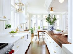 I thought I was over a white kitchen and then I saw this one. I love the warmth the butcher block brings in. It reminds me of my old…