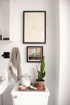 Small bathroom, I like the plant on top of the commode Greenery simple with a candle, heehee
