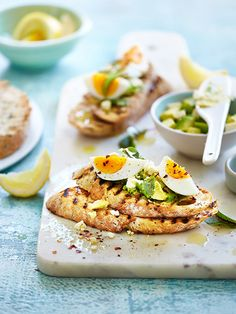 Avocado toasts with egg, feta and lemon. Recipe and Styling by Ellie Vernon www.inourkitchen.com.au