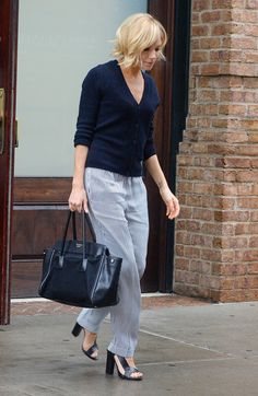 Sienna Miller's Look for 2015 (15/01) - Vogue Bye-Bye Boho: Sienna Miller's New Look is Streamlined, Modern, and Understated   Chinti and Parker Pineapple cardigan, Belstaff pants, Prada bag, and Pierre Hardy shoes