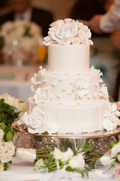 Wedding cake for the LaFrance/Pappas Wedding on June 14th, 2012 at the Planters Inn. Cake by Claire Chapman of the Peninsula Grill. Photo by Corrie & James fo MCG Photography.
