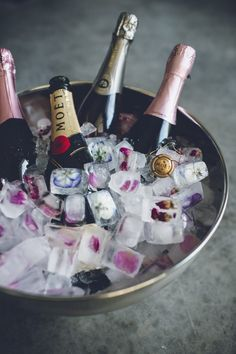 champagne ice bucket with frozen flower ice cubes