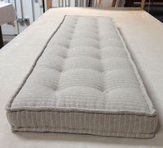 This is a French mattress I did for a client.  The edges are sewn by hand to create that old-time look and buttons are added.