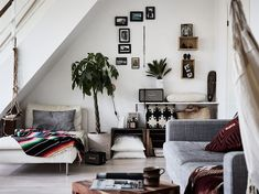 This apartment is the perfect example of how to do small, open space. Guest day bed in the living room is so smart.