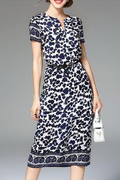 Nexiia Purplish Blue Printed Belted Dress | Midi Dresses at DEZZAL