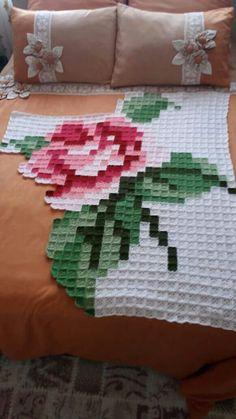 Crochet granny squares in giant rose pattern.