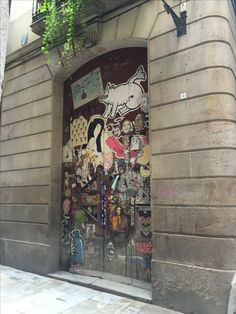 This street art is not graffiti or spray paint, but a sticker that was placed onto this door en El Born. While the girl is nude and wearing knee high pink socks, there is something seemingly innocent about her face. It may be the fact that it is extremely cartoonish. Most woman are still represented and portrayed in this manner of someone sexual.