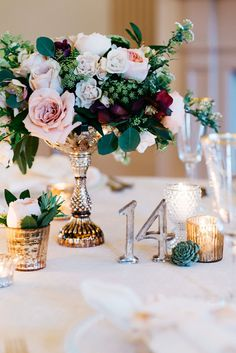 Vintage Gold Centerpiece with Modern Metallic Table Numbers | Alisha Maria Photography | http://heyweddinglady.com/modern-indoor-garden-wedding-elegant-ballroom/