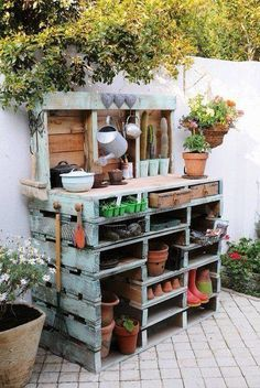 I'd love a small potting station like this one on the side of the north east side of the house - out of the way and not visible from any windows.