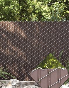 Chain Link fence with privacy slats. Cheaper alternative than wood fence.