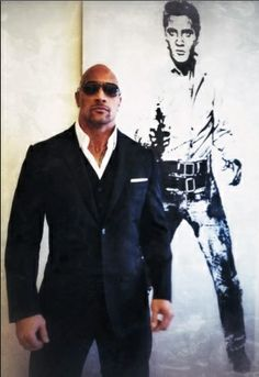 Dwayne The Rock Johnson, I love that's he's standing next to an Elvis picture.