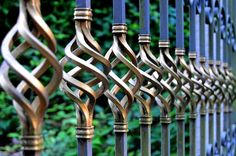 Even a standard wrought iron fence can also integrate color and intricate detail. It might be cost prohibitive for a large yard, but I would consider this style for a gateway. If you're looking for 118 fence ideas of all types, try this guide. Wrought Iron Fences, Metal Fence, Wrought Iron Decor, Metal Gates, Metal Railings, Iron Gates, Forced Perspective Photography, Types Of Fences, Driveway Gate