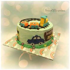 Chu chu train with train n bus edible cut out chocolate figurine , whip cream single tier cake