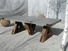 The legs are a bit weird. But I like the idea of a concrete table top and reclaimed wood legs. Concrete Table Top, Concrete Wood, Concrete Design, Polished Concrete, Slab Table, Wood Patio, Diy Patio, Concrete Furniture, Diy Furniture