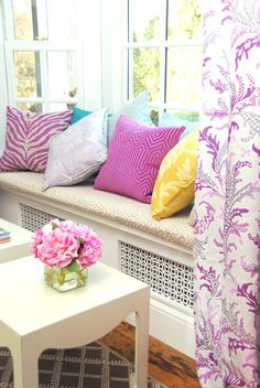 If you don't want to swap you ugly radiator for a pretty one, why not conceal it behind a grille, or under a window seat. This will also keep kids away from the heat source. image from roomrxblogspot.com