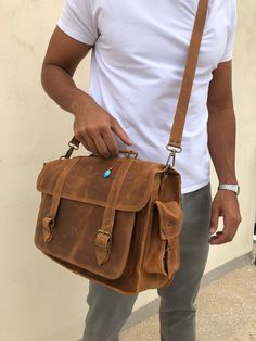 Handmade leather messenger bag with two side pockets, made from genuine leather in deep brown color decorated with a unique key ring. Briefcase For Men, Leather Briefcase, Brown Leather Messenger Bag, Messenger Bags, Beautiful Sandals, Evil Eye Pendant, Leather Bags Handmade, Laptop Bag, Natural Leather