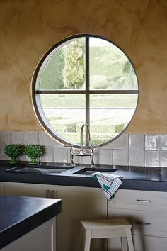 Lovely circular kitchen window - Paul Bangay's home Share-Design-Blog-Paul-Bangay-Stonefields-Home-Photo-Lucas-Allen-05