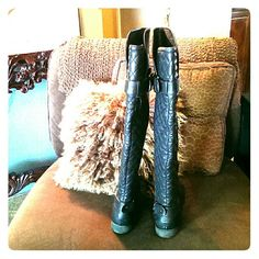 Over the knee boots Stylish over the knee black leather boots.  Never worn. Has inside zipper and a top and bottom buckle.  Pretty diamond pattern on the back of the boot from the heel all the way up. Not Rated Shoes Over the Knee Boots