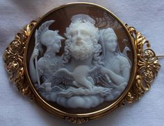 """Zeus, Hera and Athena""  Sardonyx Shell Cameo in 18k Gold Frame, France  c. 1860"