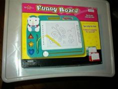 """FUNNY BOARD : Magnetic Drawing Board by Dream Art. $7.99. Easy Pick-up Handle with Multi-Angle Stand. Slide the MAGIC MOVING Button to Erase. Action Stamp Drawing, or Freehand Drawing. Drawing Shapes. """"Play and Draw"""" Magnetic Drawing Board w/ attached Pen (2004). Great toy for hours of fun! This can be used over and over!  Specially for kids, BUT can be used for endless creativity for yourself, regardless of age. Small parts, not for children under 3"""
