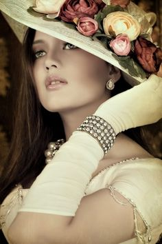 Beautiful lady with floral hat and white gloves.