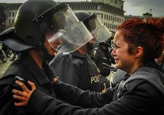 "The Story Behind This Powerful Photo Of A Police Officer And A Student Protester ""You just hold on, girl."""