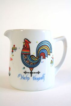 Scandanavian pitcher with rooster on it. We already have the coffee pot & mug!
