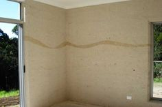 rammed earth wall . ribbon of color through wall makes a subtle but interesting accent . builder / architect unknown