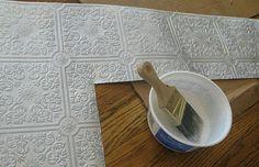 textured wall paper as backsplash.  tin-tile look