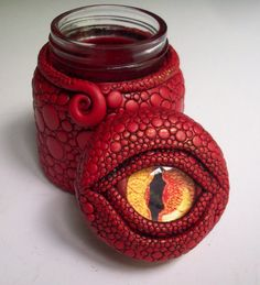 Dragon Eye Jar/ Vase Polymer Clay over Glass  This is so neat.  Looks like cabochon eye in center.  Looks like something a harry potter fan will like