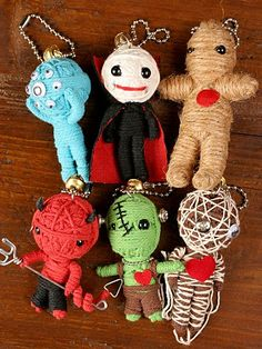 How 'freaky' cute are these?!. - my mother in law got us all little voodoo doll key chains for x-mas that look very much like these.