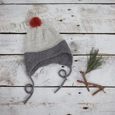 Gorgeous un-dyed grey alpaca wool cap with a brick red pompom is super comfy and adorably cute. The un-dyed yarn means it has not been exposed to any chemical treatment, and the ultra soft alpaca will