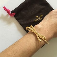 "Gold bow hinge bangle bracelet Only worn once for a shoot! Comes with original jewelry bag. A feminine bow gleams atop a slim, polished hinged bangle to create a pretty accessory. 6 5/8"" inner circumference; 1/2"" width. Hinge closure. 12k-gold plate. kate spade Jewelry Bracelets"