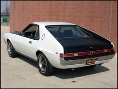 1969 AMC AMX <3 Mine was a 1970 <3 same color <3 wish I still had it !