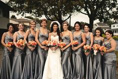Silver bridesmaids dresses?! And coral flowers. PERFECT! My dream colors (: