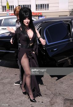 LOS ANGELES, CA - JULY Actress Cassandra Peterson (aka Elvira) attends the launch of her new signature Elvira hot dog at Pink's Hot Dogs on July 2012 in Los Angeles, California. (Photo by Barry King/WireImage) Elvira Movies, Motard Sexy, Wwe Divas Paige, Cassandra Peterson, Goth Women, Looks Plus Size, Sexy Legs And Heels, Actrices Hollywood, Sexy Older Women